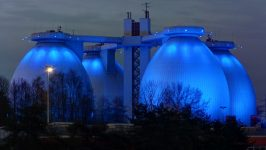 Image of egg-shaped anaerobic digesters at night.