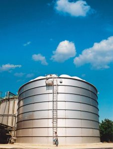 One of Stallkamp's large stainless steel tanks, - Stallkamp Wastewater tank with self-supporting ribbed dome roof.