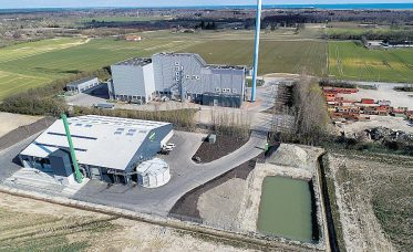 Visible adjacent to a thermal energy-from-waste plant is Gemidan's new pre-treatment facility in Denmark.