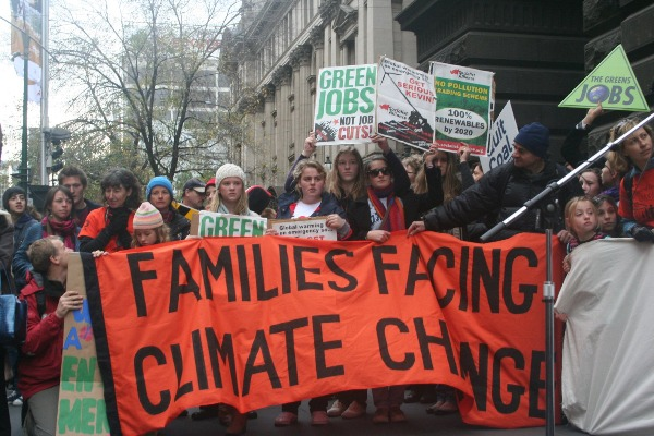 Families facing climate change placard.