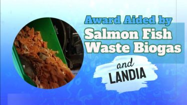 "Image shows text saying: ""Award aided by salmon fish waste biogas"""